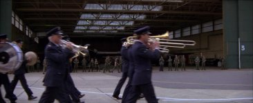 The USAF Marching Band preceeds the circus parade as the procession enters the Flightline. Notice the F-111's in the hangar.